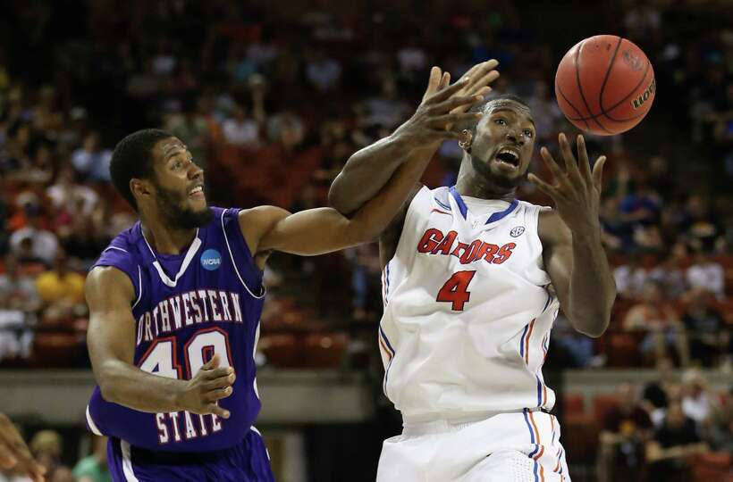 Marvin Frazier #40 of the Northwestern State Demons and Patric Young #4 of the Florida Gators.