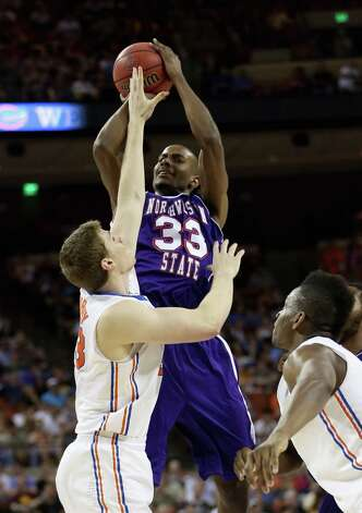 James Hulbin #33 of the Northwestern State Demons goes up for a shot over Erik Murphy #33 of the Florida Gators. Photo: Ronald Martinez, Getty Images / 2013 Getty Images
