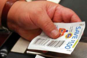 Times Union staff photo by John Carl D'Annibale:   A clerk handles coupons at the Route 9, Price Chopper in Latham, Friday morning July 6, 2007.  FOR WECHSLER STORY
