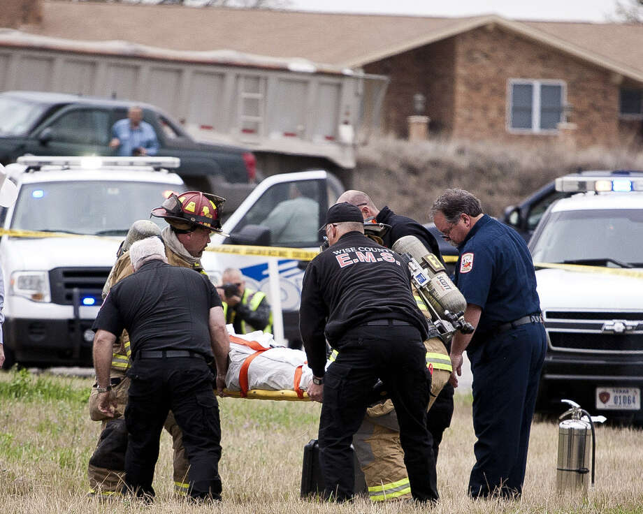Emergency personnel carry Evan Spencer Ebel after a high-speed chase and shootout with police in Decatur. Officials say Ebel crashed his car and fired on officers. Photo: Jimmy Alford / Wise County Messenger