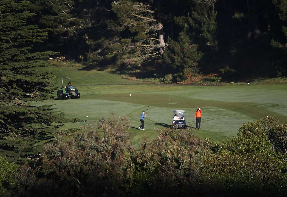 Golfers eye their shots on a fairway at the Lake Merced Golf and Country Club in Daly City, Calif. on Thursday, March 21, 2013.