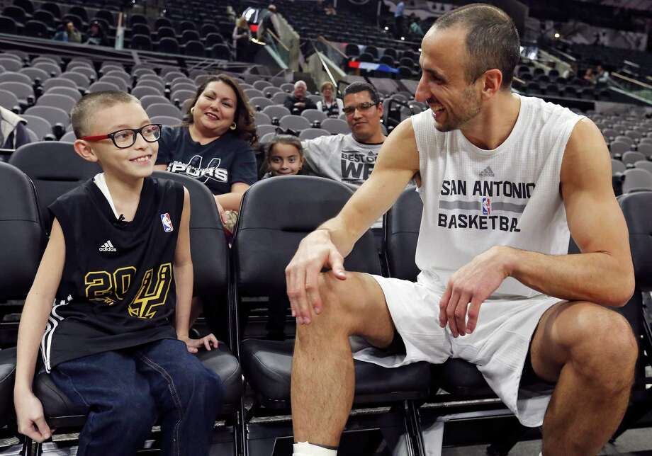 Ginobili San Miguel-Ramirez, 10, talks with San Antonio Spurs' Manu Ginobili before the Spurs and Utah Jazz game as his mother Renee San Miguel-Ramirez, 36, (rear from left) sister Georgina San Miguel-Ramirez, 8, and father Jorge Ramirez, 38, look on Monday Dec. 14, 2015 at the AT&T Center. Photo: Edward A. Ornelas, San Antonio Express-News / © 2015 San Antonio Express-News