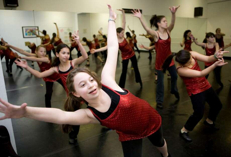 Leigh Konak, center, rehearses with the Uptempo Dance Company in Pound Ridge, NY, as they prepare for a performance at the Orange Bowl in Miami on January 5. Dance groups from all over the country will be performing the dance and this group will represent the state of New York. Photo: Kerry Sherck / Stamford Advocate Freelance