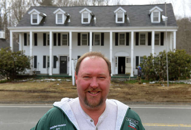 Owner Jay Borkowsk poses in front of Oxford House along Route 67 in Oxford, Conn. on March 22, 2013. He bought the landmark building and plans to develop it for potential business like a bakery, coffee house and professional offices upstairs. Photo: Christian Abraham / Connecticut Post