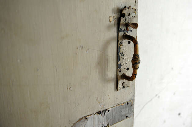 An original handle still adorns a door for a room on the third floor inside the Oxford House along Route 67 in Oxford, Conn. on March 22, 2013. Owner Jay Borkowsk bought the landmark building and plans to develop it for potential business like a bakery, coffee house and professional offices upstairs. Photo: Christian Abraham