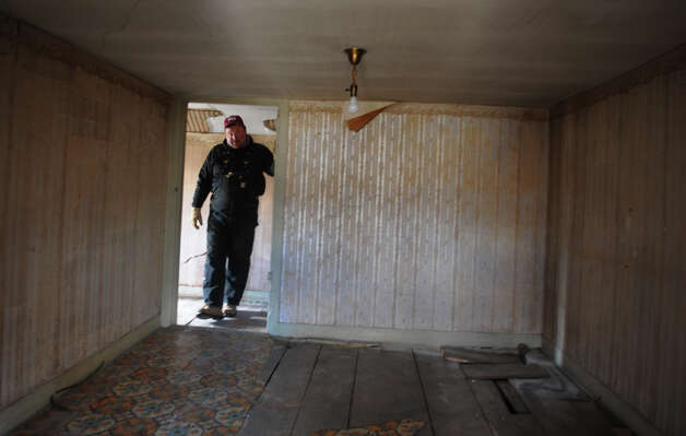 Karl Borkowski walks through the third floor of the historic Oxford House along Route 67 in Oxford, Conn. on March 22, 2013. Karl Borkowski who is doing a lot of the renovation. Karl's brother Jay bought the landmark building and plans to develop it for potential business like a bakery, coffee house and professional offices upstairs. Photo: Christian Abraham