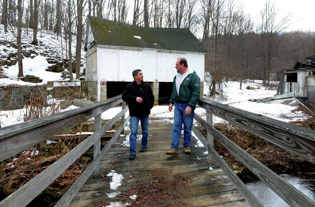 Oxford House owner Jay Borkowski, in green jackeet, gives his friend John Bogart a tour of the historic building along Route 67 in Oxford, Conn. on March 22, 2013. Borkowski bought the landmark building and plans to develop it for potential business like a bakery, coffee house and professional offices upstairs. Photo: Christian Abraham