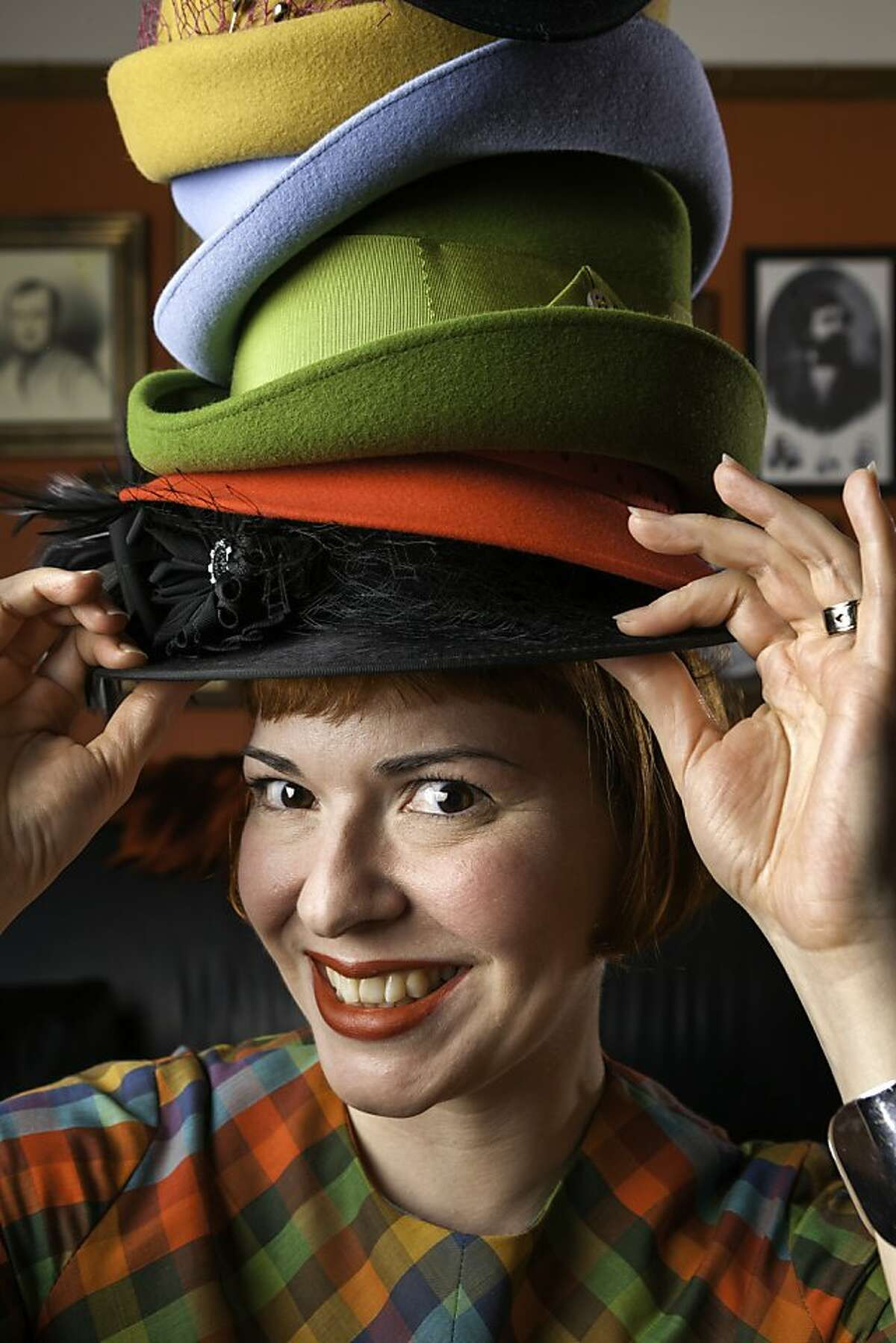 Tricia Roush wears a stack of hats of her own creation in her home in the San Francisco, CA Mission District on Sunday, March 17, 2013.