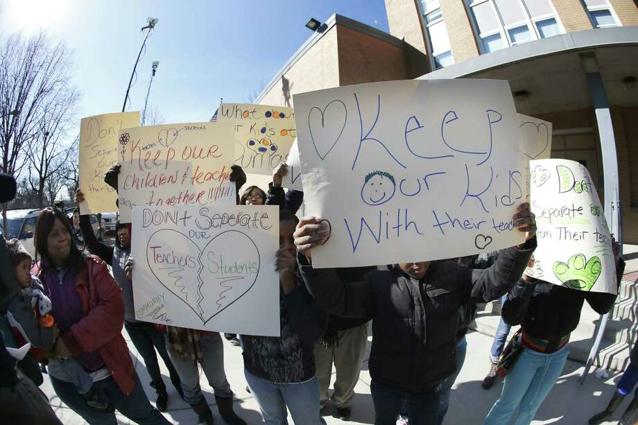 Parents of students at the Dumas Technology Academy Elementary School protest the planned closing of the facility, one of 54 Chicago schools earmarked for closing. Photo: Charles Rex Arbogast / Associated Press