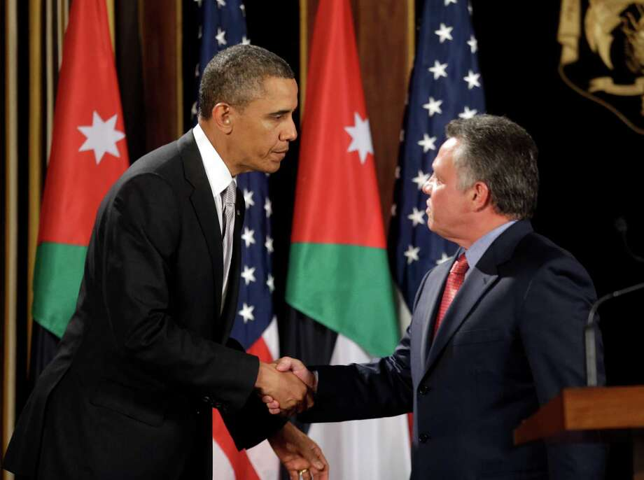 U.S. President Barack Obama, left, and Jordan's King Abdullah II, right, shake hands following their joint new conference at the King's Palace in Amman, Jordan, Friday, March 22, 2013. (AP Photo/Pablo Martinez Monsivais) Photo: Pablo Martinez Monsivais
