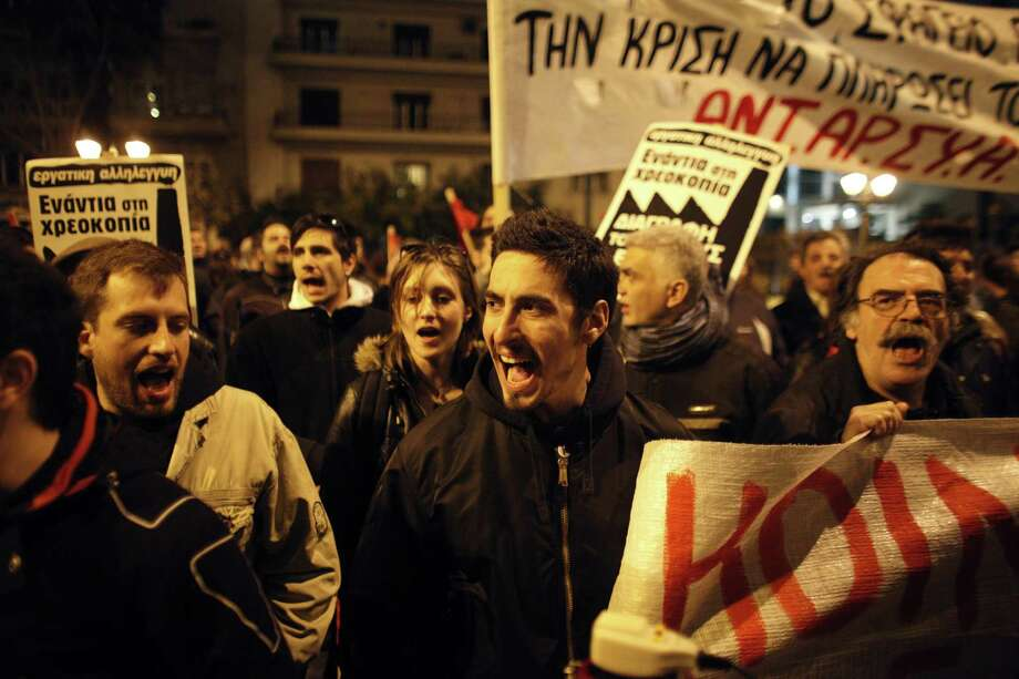 Demonstrators in Athens, Greece, protest the European Union's handling of the bailout crisis in Cyprus, which is threatened with bankruptcy and whose banks are closed until at least Tuesday. Photo: Kostas Tsironis / Associated Press