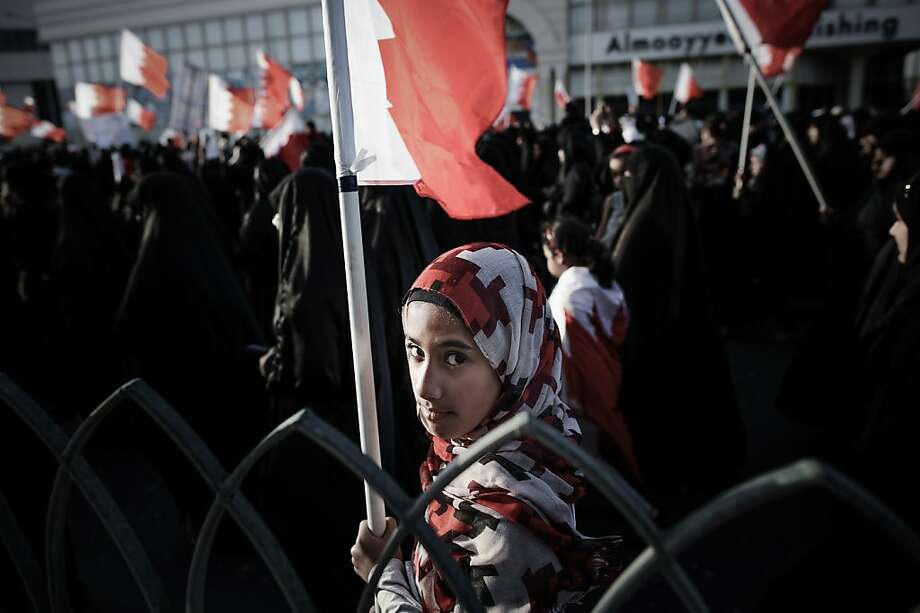 A Bahraini girl holds a national flag during an anti-government rally in solidarity with jailed human rights activist, Nabeel Rajab on March 22, 2013 in the village of Belad Al Qadeem, in a suburb of Manama. The International Federation for Human Rights says around 80 people have been killed in Bahrain since violence first broke out on February 14, 2011 when thousands of protesters camped out in Manama's Pearl Square, taking their cue from the Arab Spring uprisings. MOHAMMED AL-SHAIKH/AFP/Getty Images Photo: Mohammed Al-shaikh, AFP/Getty Images