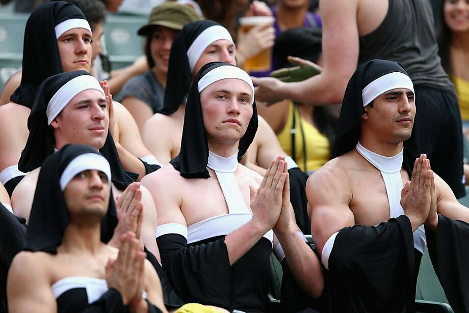 The habit: An unexpected tourney -Sisters of Perpetually Bare Shoulders pray for their team at the Hong Kong Sevens rugby competition in So Kon Po, Hong Kong. Photo: Cameron Spencer, Getty Images