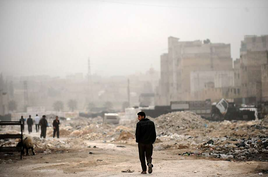 A Syrian man walks past destruction in the northern city of Aleppo on March 22, 2013. The UN lamented the escalating violence in Syria and extended a probe into widespread human rights violations in the war-torn country. BULENT KILIC/AFP/Getty Images Photo: Bulent Kilic, AFP/Getty Images