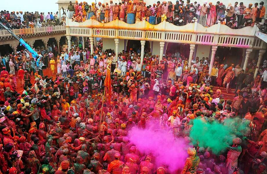 Indian Hindu devotees participate in rituals for the Lathmar Holi festival at the Nandji Temple in Nandgaon on March 22, 2013. Lathmar Holi is a local celebration, but it takes place well before the national Holi day on March 27. Sanjay Kanojia/AFP/Getty Images Photo: Sanjay Kanojia, AFP/Getty Images