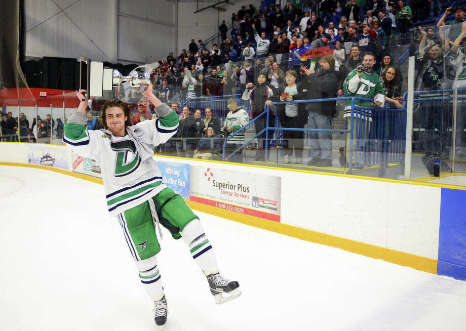 Danbury's Tyler Noseworthy hoists the Commissioner's Cup above his head after the Danbury Whalers defeated the Dayton Demons 6-3 to win the Commisioner's Cup championship series at Danbury Arena in Danbury, Conn. on Friday, March 22, 2013. Photo: Tyler Sizemore / The News-Times