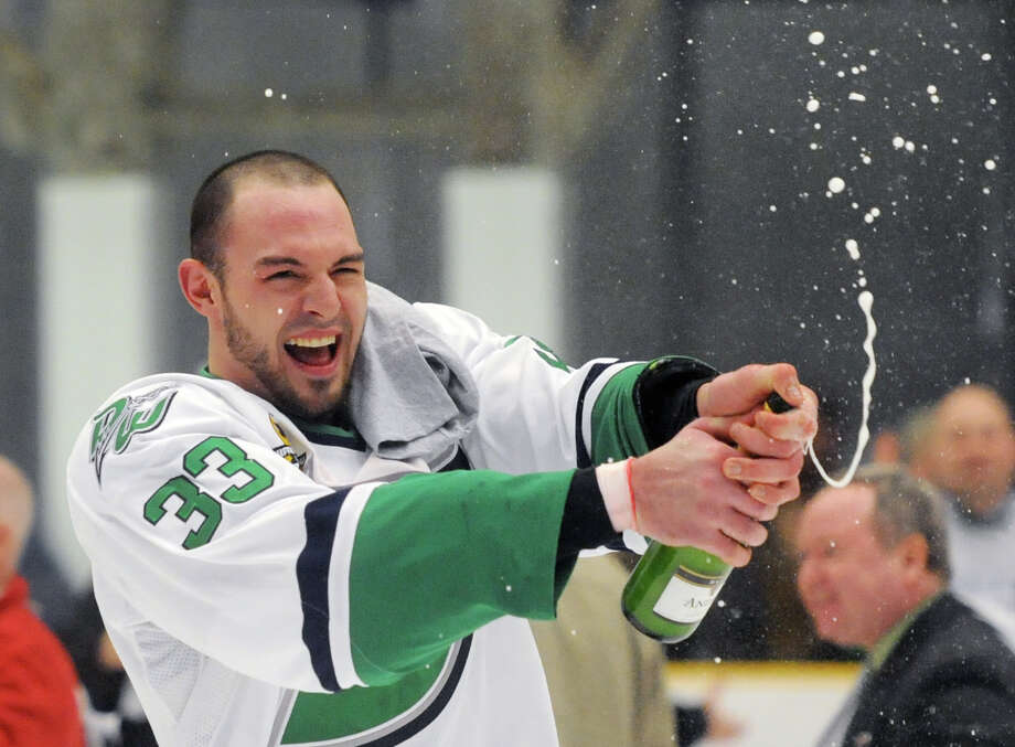 Danbury's Anthony Pisano cracks open a bottle of champaign after the Danbury Whalers defeated the Dayton Demonz 6-3 to win the Commisioner's Cup championship series at Danbury Arena in Danbury, Conn. on Friday, March 22, 2013. Photo: Tyler Sizemore / The News-Times