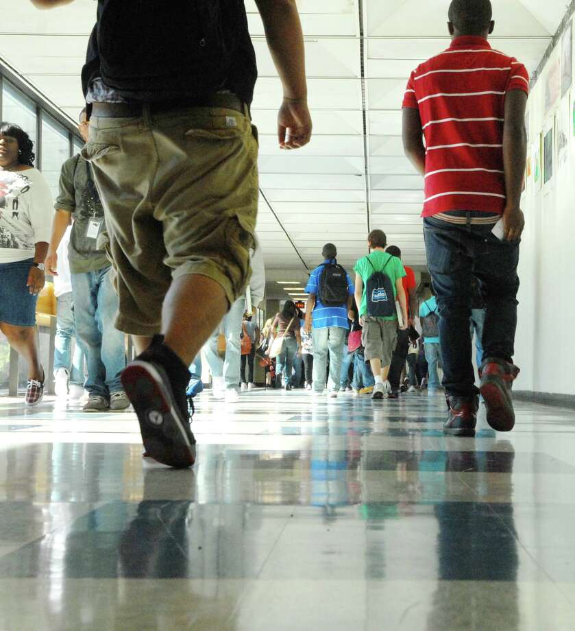 Students make their way between classes on new tile floors at Albany High School on first day of classes in Albany, NY on Tuesday, Sept. 7, 2010.  Albany High School starts the new school year with changes, including new tile floors which replace the carpets and new technology for the teachers and students.  The administration and teachers must work this year to raise achievement for all students.  (Paul Buckowski / Times Union) Photo: Paul Buckowski / 00010169A
