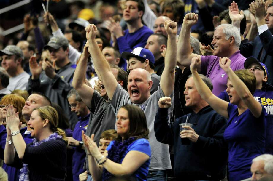 UAlbany fans cheer for their team during their second round NCAA Tournament against Duke on Friday, March 22, 2013, at Wells Fargo Center in Philadelphia, Penn. (Cindy Schultz / Times Union) Photo: Cindy Schultz