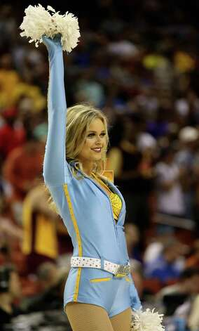 UCLA Bruins cheerleaders cheer at the game against the Minnesota Golden Gophers. Photo: Ronald Martinez, Getty Images / 2013 Getty Images
