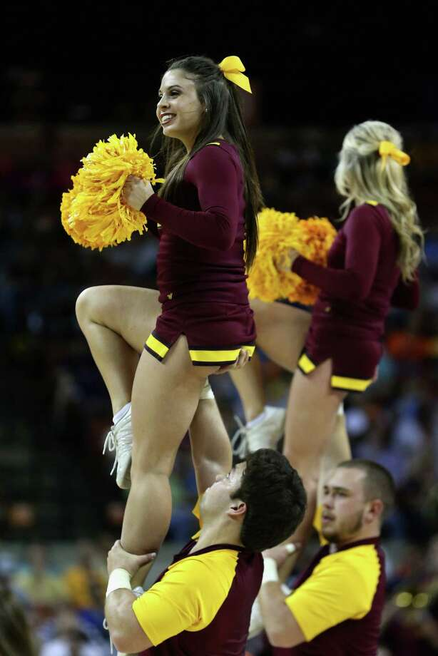 The Minnesota Golden Gophers cheerleaders perform during the game against the UCLA Bruins. Photo: Ronald Martinez, Getty Images / 2013 Getty Images