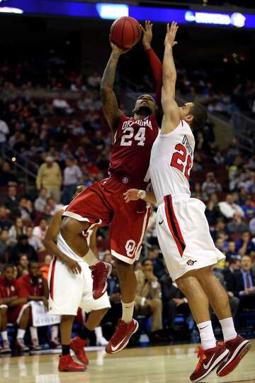 Romero Osby #24 of the Oklahoma Sooners drives for a shot attempt in the second half against JJ O'Br