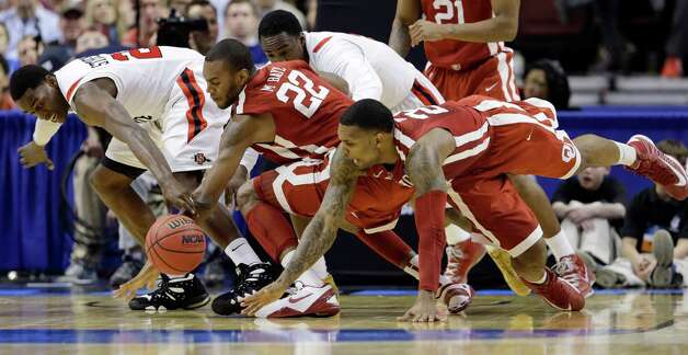 San Diego State's Deshawn Stephens, left, and Jamaal Franklin chase down a loose ball against Oklahoma's Amath M'Baye, second from left, and Romero Osby during the first half of a second-round game of the NCAA college basketball tournament, Friday, March 22, 2013, in Philadelphia. (AP Photo/Matt Rourke) Photo: Matt Rourke, Associated Press / AP