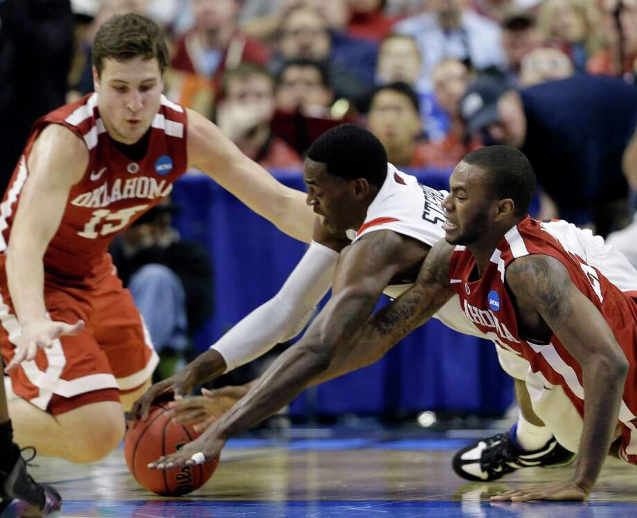 San Diego State's Deshawn Stephens, center, chases down a loose ball against Oklahoma's Amath M'Baye, right, and Tyler Neal during the first half of a second-round game of the NCAA college basketball tournament, Friday, March 22, 2013, in Philadelphia. (AP Photo/Matt Rourke) Photo: Matt Rourke, Associated Press / AP
