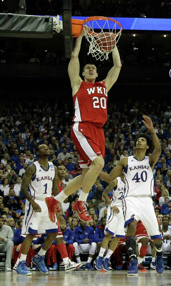 Western Kentucky center Aleksejs Rostov (20) dunks the ball during the first half of a second-round game against Kansas in the NCAA college basketball tournament on Friday, March 22, 2013, in Kansas City, Mo. (AP Photo/Charlie Riedel) Photo: Charlie Riedel, Associated Press / AP