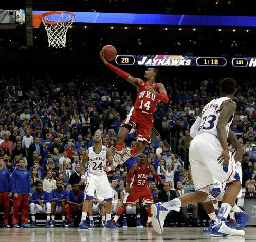 Western Kentucky guard Jamal Crook goes in for a shot during the first half of a second-round game against Kansas in the NCAA men's college basketball tournament Friday, March 22, 2013, in Kansas City, Mo. (AP Photo/Charlie Riedel) Photo: Charlie Riedel, Associated Press / AP