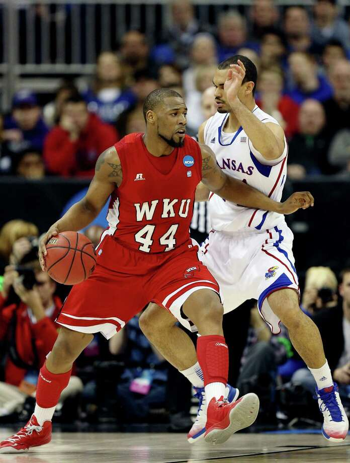 George Fant #44 of the Western Kentucky Hilltoppers drives against Perry Ellis #34 of the Kansas Jayhawks in the first half. Photo: Ed Zurga, Getty Images / 2013 Getty Images