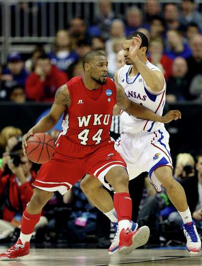 George Fant #44 of the Western Kentucky Hilltoppers drives against Perry Ellis #34 of the Kansas Jay