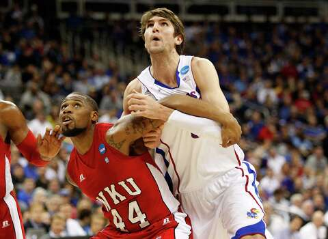 George Fant #44 of the Western Kentucky Hilltoppers boxes out Jeff Withey #5 of the Kansas Jayhawks in the first half during the second round. Photo: Ed Zurga, Getty Images / 2013 Getty Images