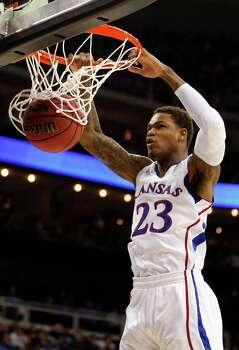 Ben McLemore #23 of the Kansas Jayhawks dunks against the Western Kentucky Hilltoppers in the first half during the second round. Photo: Ed Zurga, Getty Images / 2013 Getty Images
