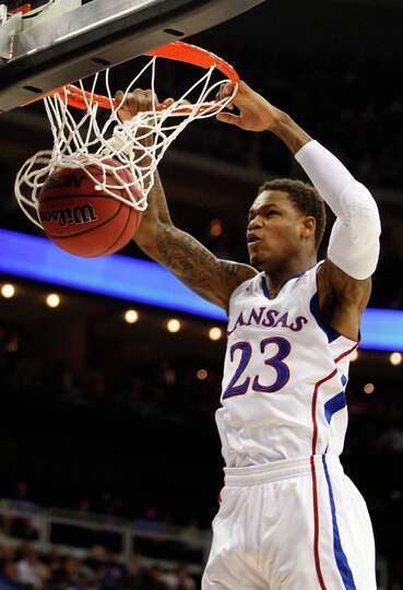 Ben McLemore #23 of the Kansas Jayhawks dunks against the Western Kentucky Hilltoppers in the first