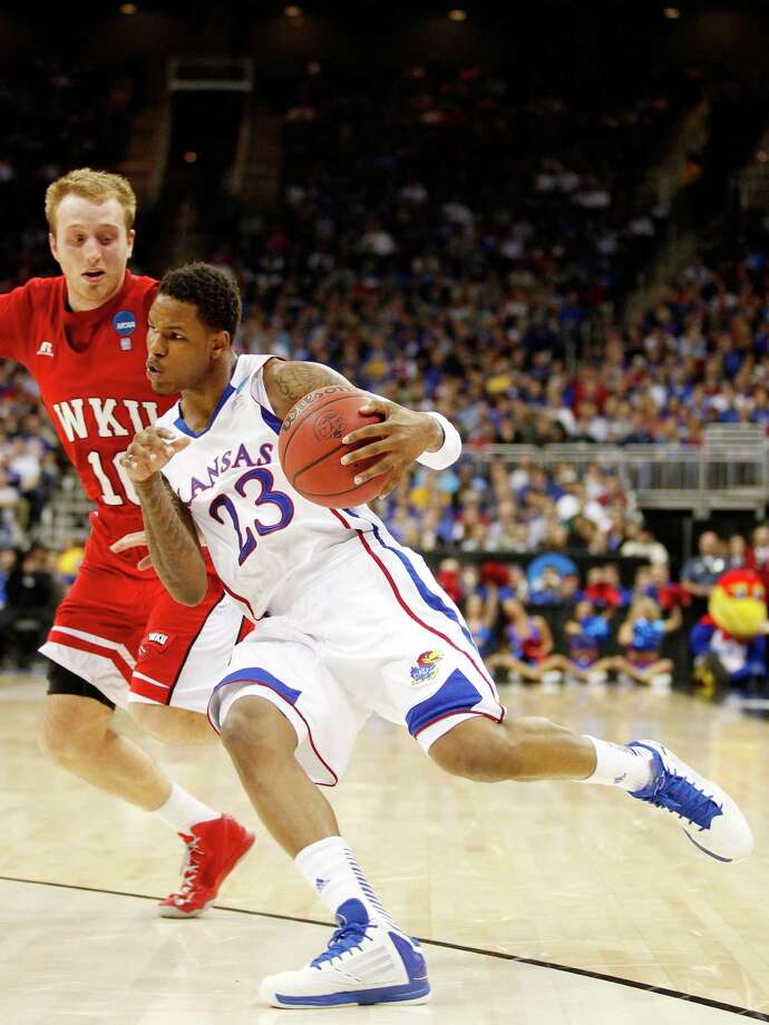 Kansas 64, Western Kentucky 57KANSAS CITY, MO - MARCH 22: Ben McLemore #23 of the Kansas Jayhawks drives against Caden Dickerson #10 of the Western Kentucky Hilltoppers in the first half during the second round of the 2013 NCAA Men's Basketball Tournament at the Sprint Center on March 22, 2013 in Kansas City, Missouri. Photo: Ed Zurga, Getty Images / 2013 Getty Images