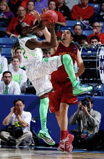 Jerian Grant #22 of the Notre Dame Fighting Irish handles the ball against Georges Niang #31 of the