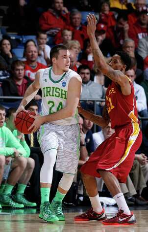 Pat Connaughton #24 of the Notre Dame Fighting Irish handles the ball against Will Clyburn #21 of the Iowa State Cyclones in the second half. Photo: Joe Robbins, Getty Images / 2013 Getty Images