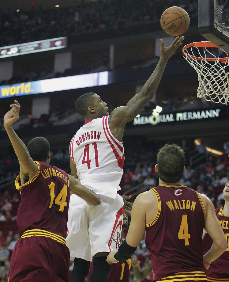 Rocekts forward Thomas Robinson scores a basket during the third quarter. Photo: James Nielsen / © 2013 Houston Chronicle