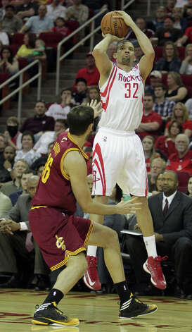 Francisco Garcia of the Rockets attempts a 3-pointer during the fourth quarter. Photo: James Nielsen / © 2013 Houston Chronicle