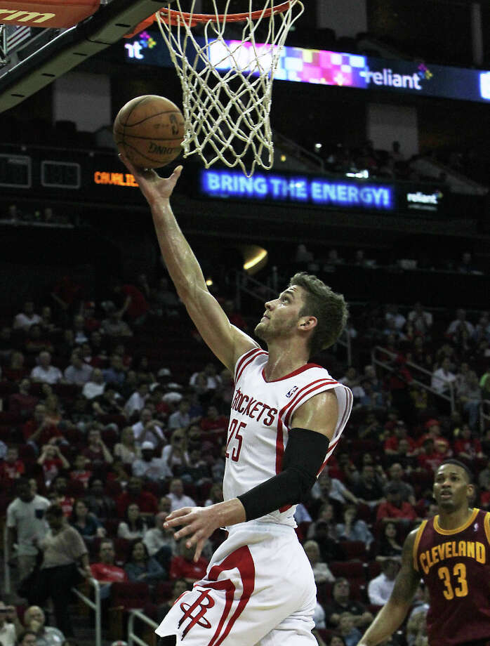 Rockets forward Chandler Parsons attempts a shot against the Cavaliers. Photo: James Nielsen / © 2013 Houston Chronicle
