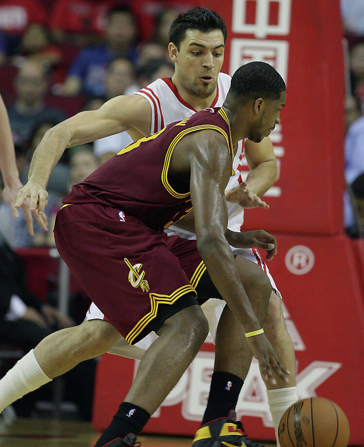 Carlos Delfino of the Rockets defends Tristan Thompson of the Cavaliers. Photo: James Nielsen / © 2013 Houston Chronicle