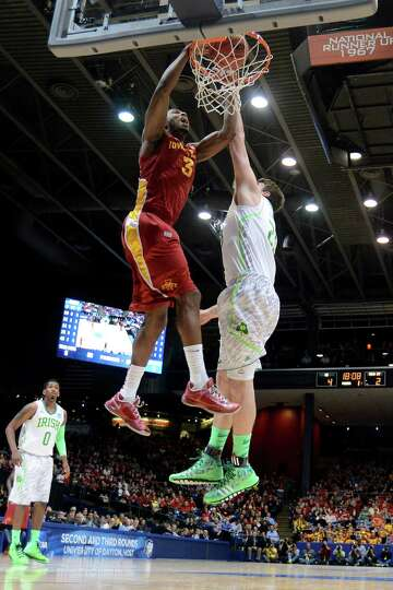 Melvin Ejim #3 of the Iowa State Cyclones goes up for a dunk against Tom Knight #25 of the Notre Dam