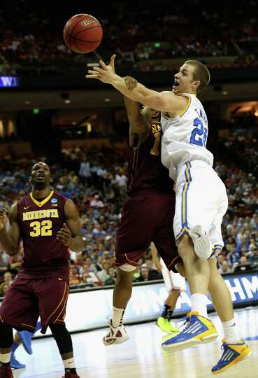 Josh Thomas #22 of the UCLA Bruins reaches for the ball against the Minnesota Golden Gophers.