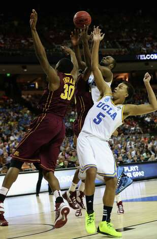 Shabazz Muhammad #15 and Kyle Anderson #5 of the UCLA Bruins battle for the ball against Andre Ingram #30 of the Minnesota Golden Gophers. Photo: Stephen Dunn, Getty Images / 2013 Getty Images