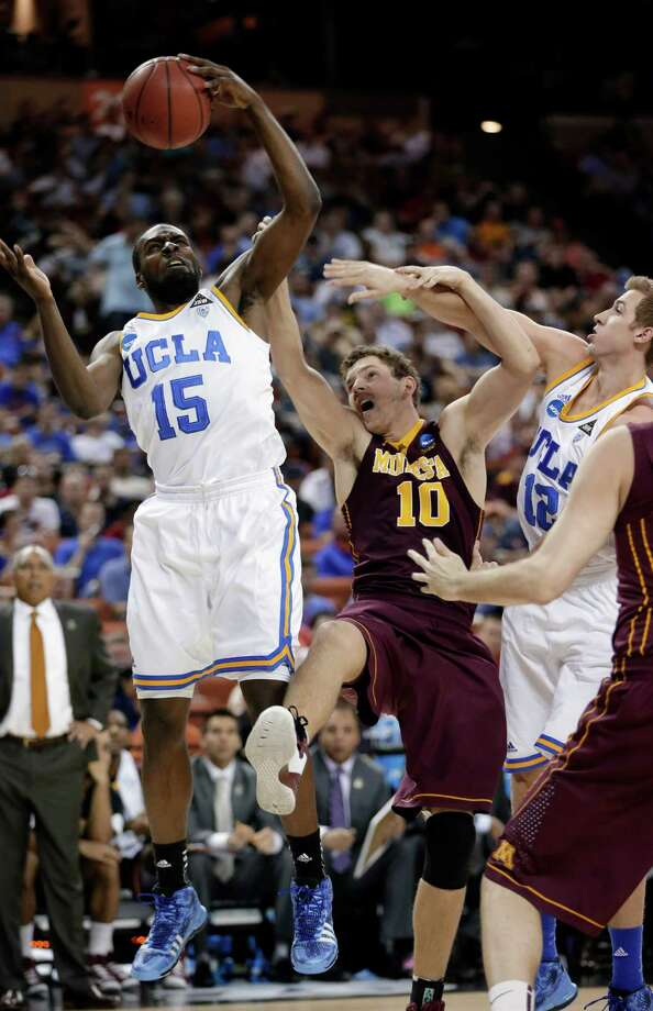 Minnesota 83, UCLA 63Minnesota's Oto Osenieks (10) reaches for a rebound with UCLA's Shabazz Muhammad (15) and David Wear (12) during the first half of a second-round game of the NCAA men's college basketball tournament Friday, March 22, 2013, in Austin, Texas. (AP Photo/Eric Gay) Photo: Eric Gay, Associated Press / AP