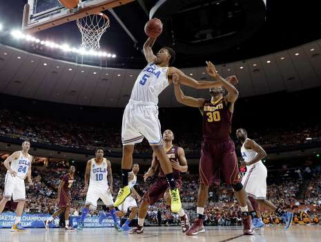 UCLA's Kyle Anderson (5) grabs a rebound in front of Minnesota's Andre Ingram (30) during the first half of a second-round game of the NCAA men's college basketball tournament Friday, March 22, 2013, in Austin, Texas. (AP Photo/David J. Phillip) Photo: David J. Phillip, Associated Press / AP