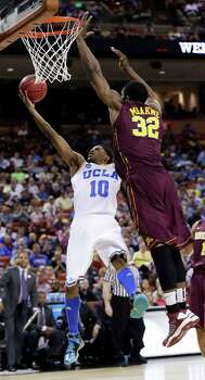 UCLA's Larry Drew II (10) shoots as Minnesota's Trevor Mbakwe (32) defends during the first half of a second-round game of the NCAA men's college basketball tournament Friday, March 22, 2013, in Austin, Texas.  (AP Photo/Eric Gay) Photo: Eric Gay, Associated Press / AP