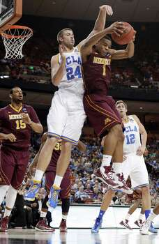 Minnesota's Andre Hollins (1) pulls down a rebound in front of UCLA's Travis Wear (24) during the first half of a second-round game of the NCAA men's college basketball tournament Friday, March 22, 2013, in Austin, Texas. (AP Photo/Eric Gay) Photo: Eric Gay, Associated Press / AP