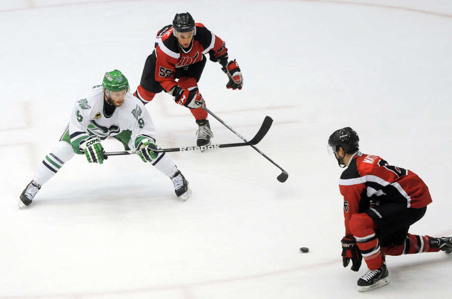Danbury's Richard Vanderhoek makes a move on two Dayton defenders during the Danbury Whalers' 6-3 win over the Dayton Demons in the Commisioner's Cup finals at Danbury Arena in Danbury, Conn. on Friday, March 22, 2013. Photo: Tyler Sizemore / The News-Times